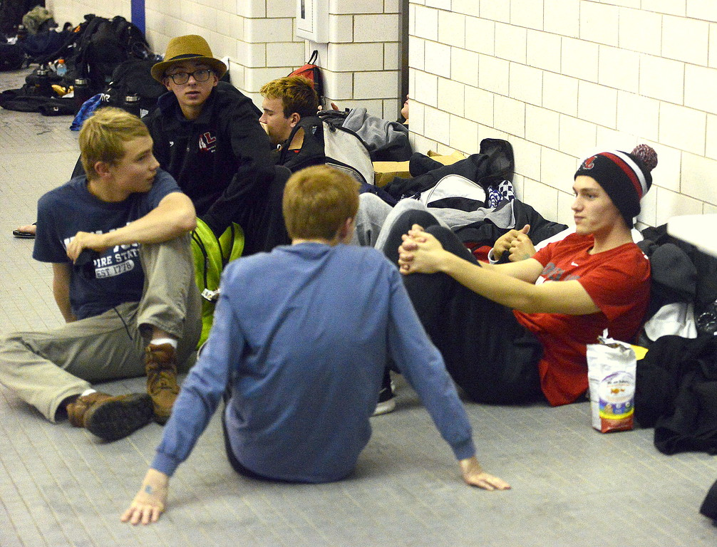 . Loveland swimmers rest after warmup at Friday\'s 4A state swimming preliminaries at the Air Force Natatorium.  (Photo by Mike Brohard/Loveland Reporter-Herald)