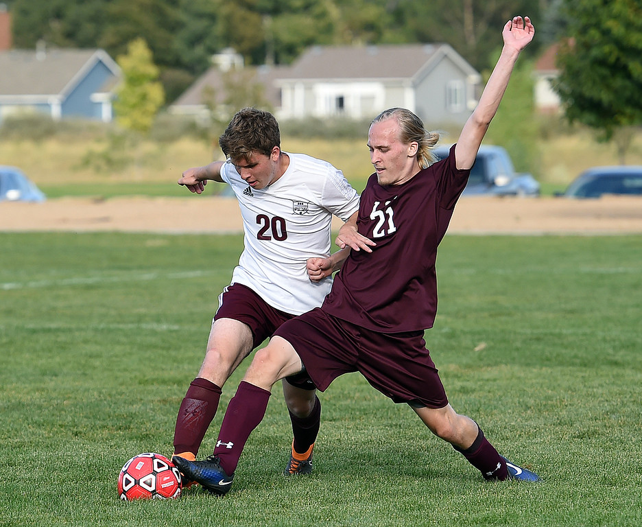 . Loveland Classical\'s Jacob Farrell and Berthoud\'s Spencer Lucero battle for control of the ball  during their soccer game Tuesday, Sept. 4, 2018, at Mehafey Park in Loveland. (Photo by Jenny Sparks/Loveland Reporter-Herald)