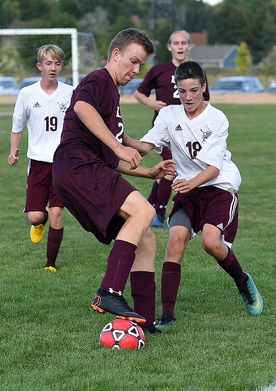 . Loveland Classical\'s Tobias Hild and Berthoud\'s Bryant Root battle for control of the ball  during their soccer game Tuesday, Sept. 4, 2018, at Mehafey Park in Loveland. (Photo by Jenny Sparks/Loveland Reporter-Herald) l 25