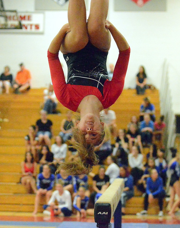 . Julia Gilcrest of Loveland dismounts from the balance beam at the Loveland Invitational gymnastics meet Friday at LHS. (Mike Brohard/Loveland Reporter-Herald)