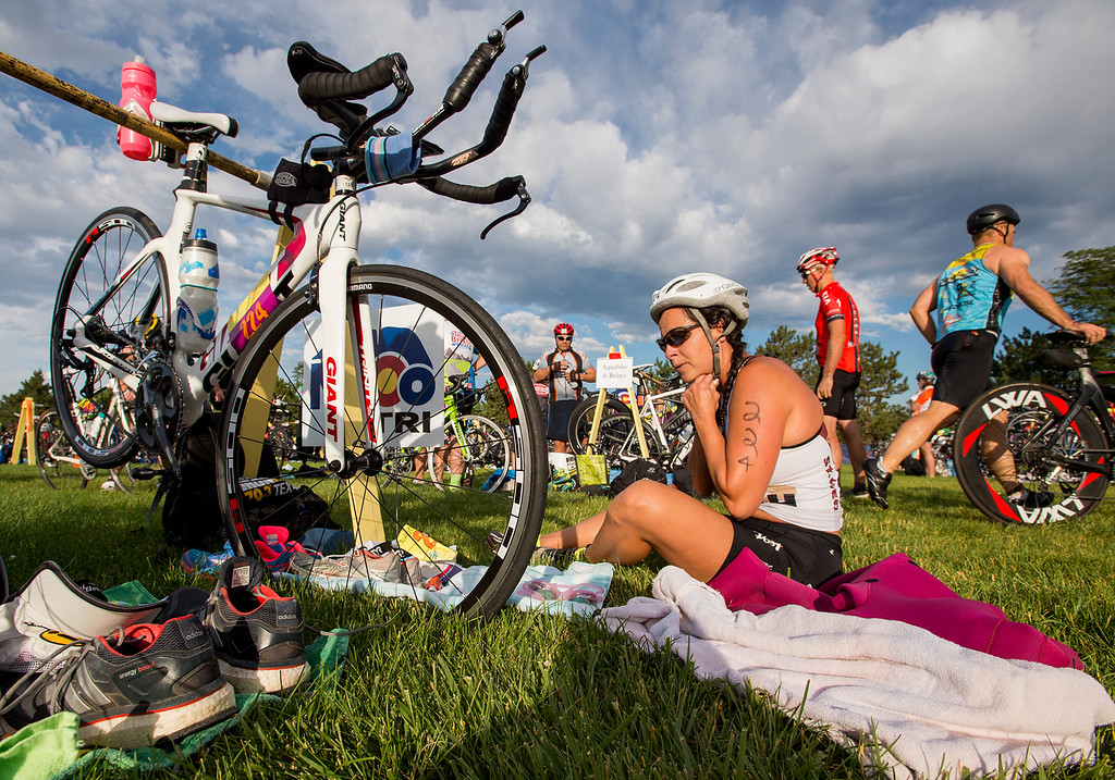. Michele Trujillo-Veit gets geared up for the 30-mile bike ride during the Loveland Lake to Lake Triathlon Saturday morning June 25, 2016 at North Lake Park. (Photo by Michael Brian/Loveland Reporter-Herald)