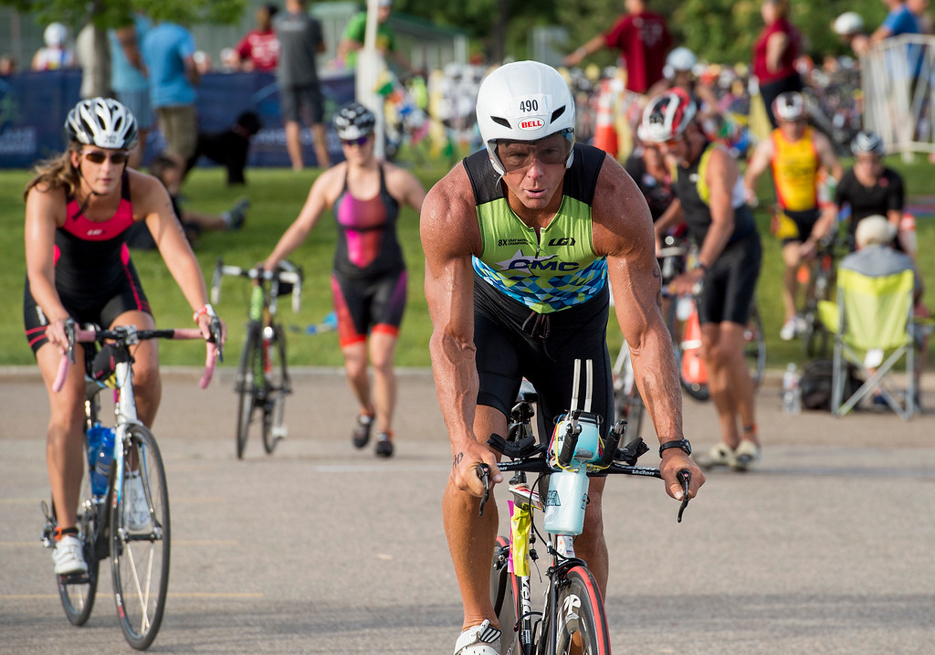 . Terry Hart, from Columbia, Mo., leaves the bicycle mount area during the Loveland Lake to Lake Triathlon Saturday morning June 25, 2016 at North Lake Park. (Photo by Michael Brian/Loveland Reporter-Herald)