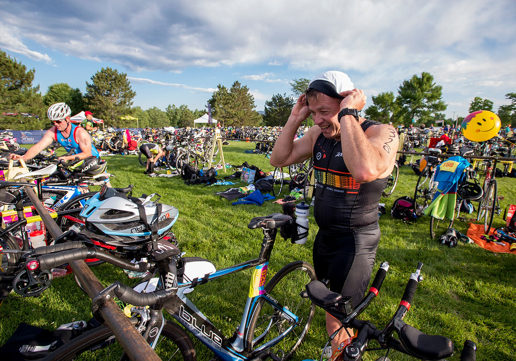 . Andrew Graziano, from Lafayette, transitions to his bicycle during the Loveland Lake to Lake Triathlon Saturday morning June 25, 2016 at North Lake Park. (Photo by Michael Brian/Loveland Reporter-Herald)