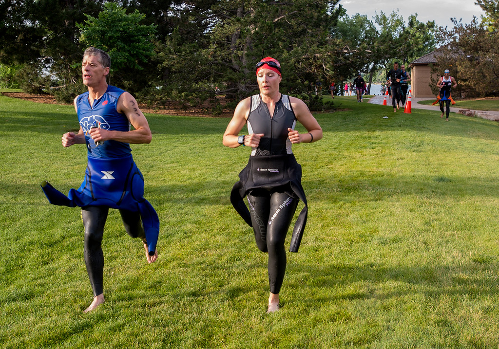 . Dan Evans, left, from Windsor, and Elizabeth Brady, from Hamilton, Ontario, run from Lake Loveland to the bicycle transition area during the Loveland Lake to Lake Triathlon Saturday morning June 25, 2016 at North Lake Park. (Photo by Michael Brian/Loveland Reporter-Herald)