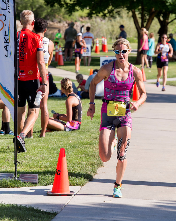. Hayley Benson charges to the finish for a women\'s overall victory in the Loveland Lake to Lake Triathlon Saturday morning June 25, 2016 at North Lake Park. (Photo by Michael Brian/Loveland Reporter-Herald)