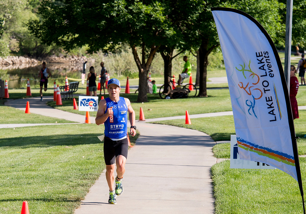 . Steve Mantell sprints to the finish for a men\'s overall victory in the Loveland Lake to Lake Triathlon Saturday morning June 25, 2016 at North Lake Park. (Photo by Michael Brian/Loveland Reporter-Herald)