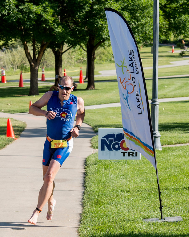 . Dan Frost, from Fort Collins, heads to the finish line during the Loveland Lake to Lake Triathlon Saturday morning June 25, 2016 at North Lake Park. (Photo by Michael Brian/Loveland Reporter-Herald)