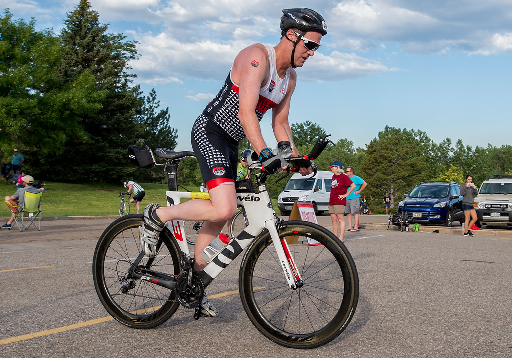 . David Sandquist looks down at his pedals as he begins a 30-mile bike ride during the Loveland Lake to Lake Triathlon Saturday morning June 25, 2016 at North Lake Park. (Photo by Michael Brian/Loveland Reporter-Herald)