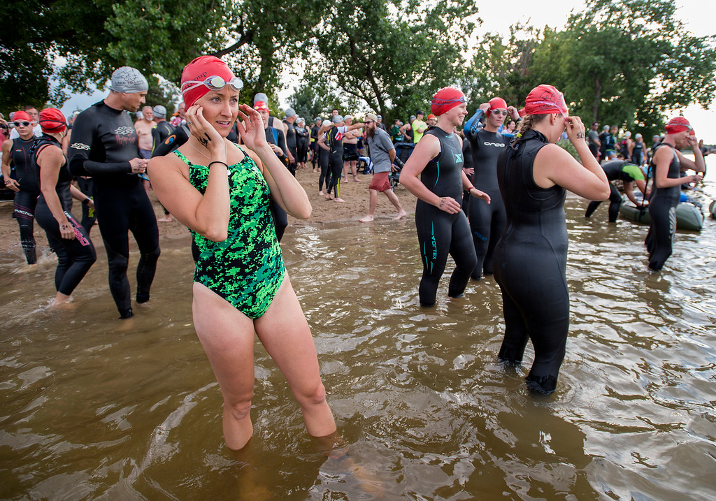 . Jackie Slocombe, from Fort Collins, prepares to join the second wave into Lake Loveland Saturday morning June 25, 2016 during the Loveland Lake to Lake Triathlon at North Lake Park. (Photo by Michael Brian/Loveland Reporter-Herald)
