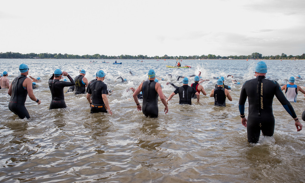 . The first wave hits the water of Lake Loveland Saturday morning June 25, 2016 during the Loveland Lake to Lake Triathlon at North Lake Park. (Photo by Michael Brian/Loveland Reporter-Herald)