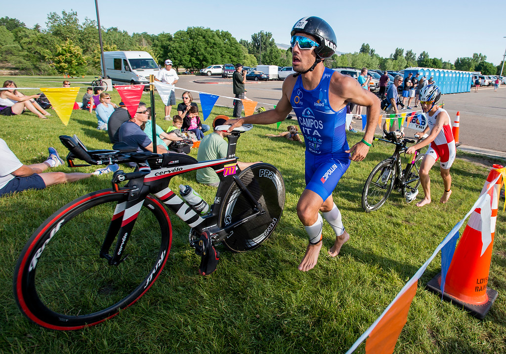 . Gui Campos, left, and Michael Dudzic, right, return from their bicycle ride during the Loveland Lake to Lake Triathlon Saturday morning June 25, 2016 at North Lake Park. (Photo by Michael Brian/Loveland Reporter-Herald)