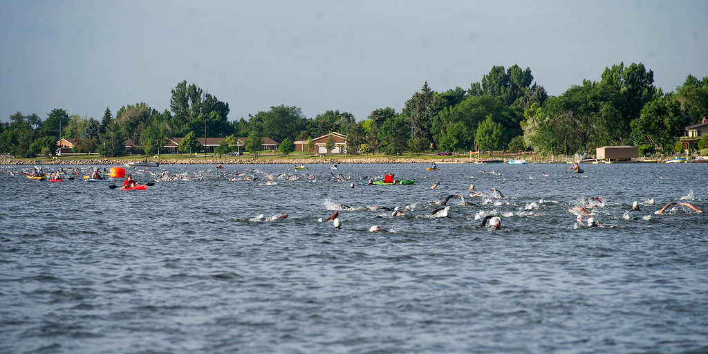 . Multiple waves of swimmers make their way across Lake Loveland during the Loveland Lake to Lake Triathlon Saturday morning June 25, 2016 at North Lake Park. (Photo by Michael Brian/Loveland Reporter-Herald)