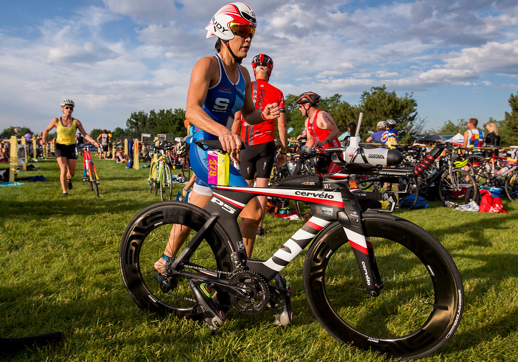 . Diana Hassel heads out of the transition area during the Loveland Lake to Lake Triathlon Saturday morning June 25, 2016 at North Lake Park. (Photo by Michael Brian/Loveland Reporter-Herald)