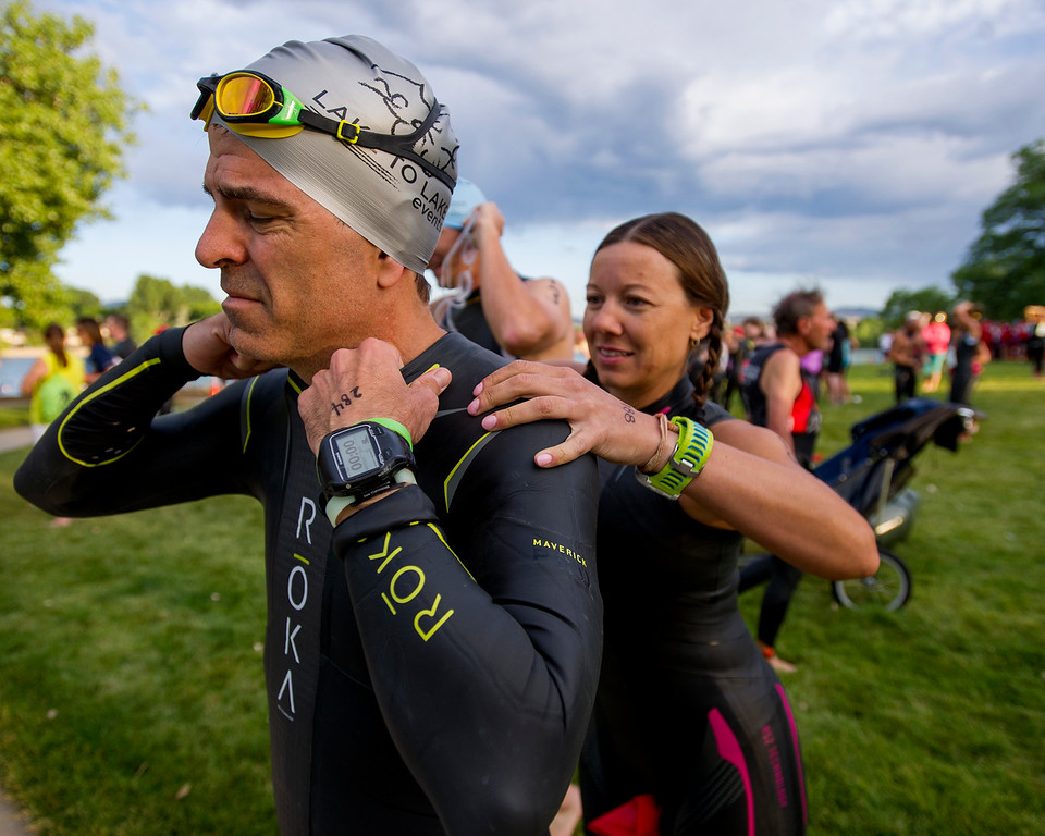 . Scott Taylor, left, and Jennifer Galeo, right, both from Boulder, prepare for the start of the Loveland Lake to Lake Triathlon Saturday morning June 25, 2016 at North Lake Park. (Photo by Michael Brian/Loveland Reporter-Herald)