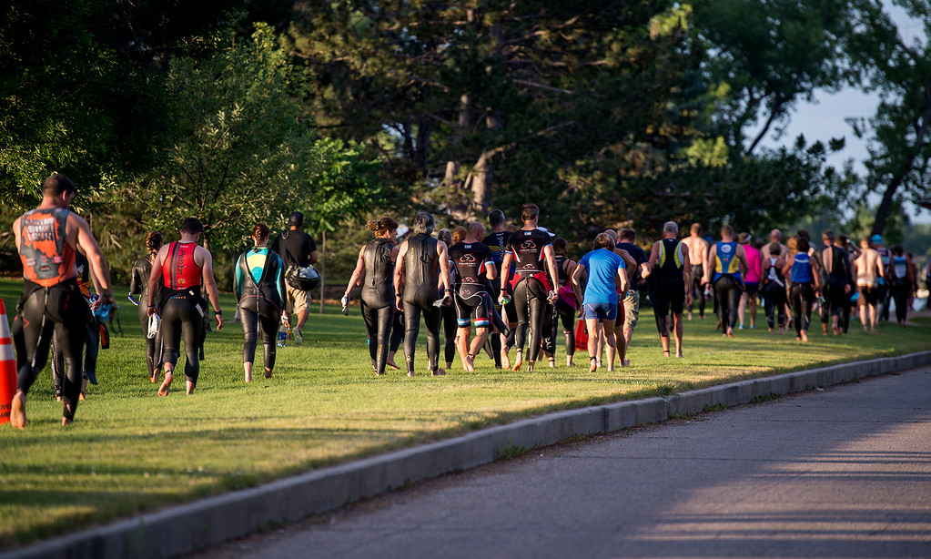 . Participants make their way to the starting point on Lake Loveland Saturday morning June 25, 2016 for the Loveland Lake to Lake Triathlon at North Lake Park. (Photo by Michael Brian/Loveland Reporter-Herald)