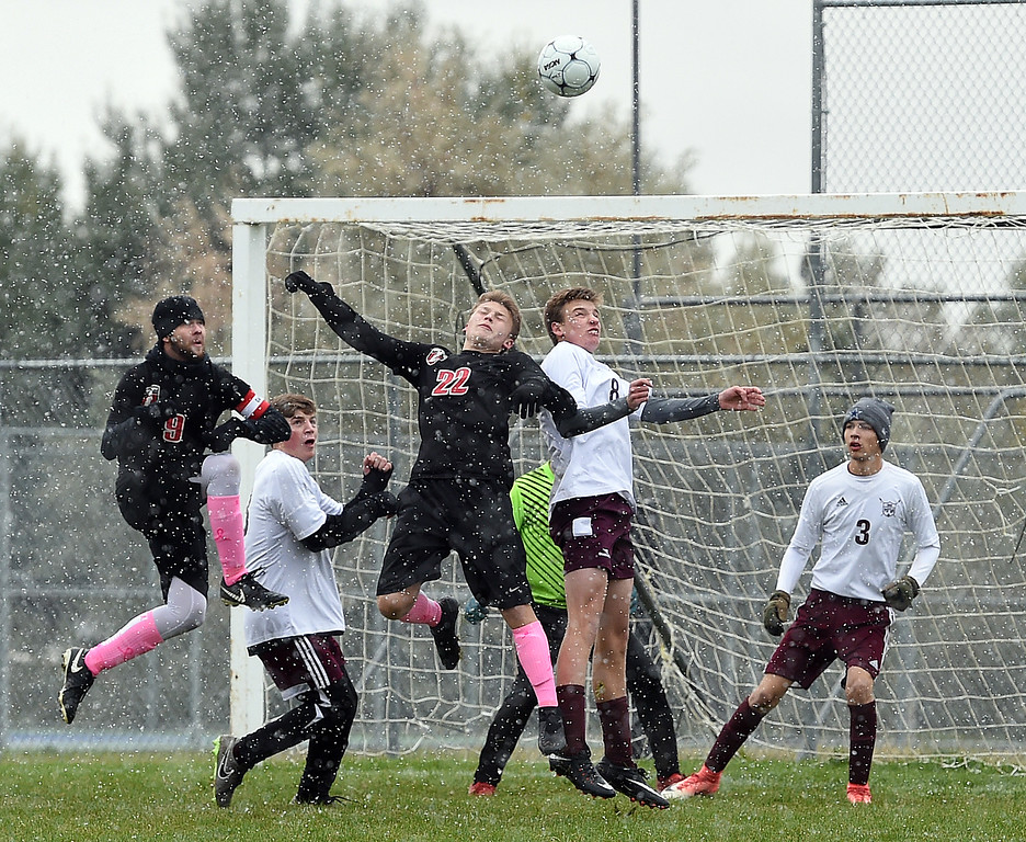 . Loveland\'s (22) Chase Graning and Berthoud\'s (8) go up for a header in front of the net during their game Wednesday, Oct. 10, 2018, at Mountain View High School in Loveland.  (Photo by Jenny Sparks/Loveland Reporter-Herald)