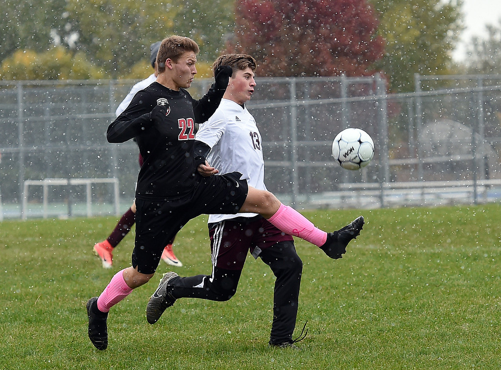 . Loveland\'s (22) Chase Graning and Berthoud\'s (13) Brock Leypoldt during their game Wednesday, Oct. 10, 2018, at Mountain View High School in Loveland.  (Photo by Jenny Sparks/Loveland Reporter-Herald)
