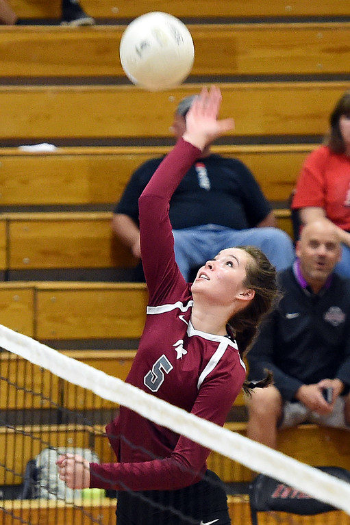 . Berthoud\'s Taylor Whittet spikes the ball during their volleyball game against Loveland on Wednesday, Sept. 5, 2018, at Loveland High. (Photo by Jenny Sparks/Loveland Reporter-Herald)