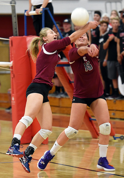Berthoud's Trinity Penny and Kailey Berry go for the ball during their volleyball game against Loveland on Wednesday, Sept. 5, 2018, at Loveland High. (Photo by Jenny Sparks/Loveland Reporter-Herald)