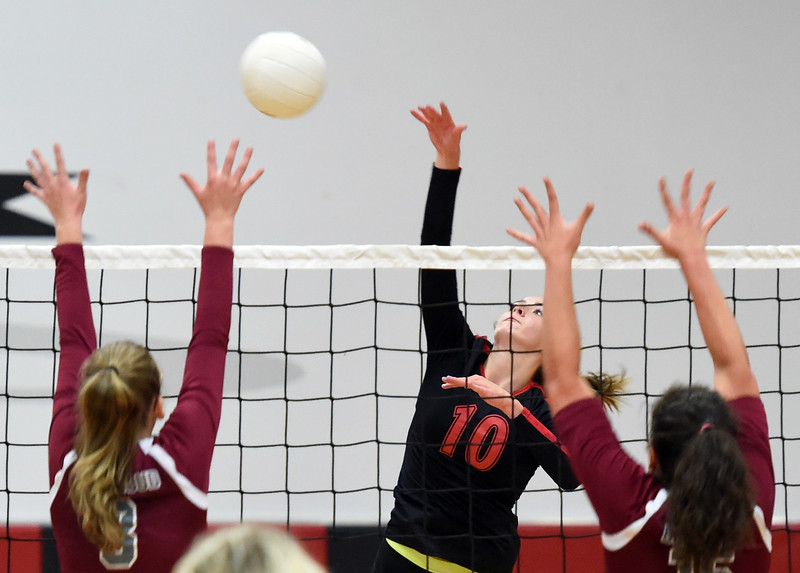 Loveland's Maddie Kinney spikes the ball during their volleyball game against Berthoud on Wednesday, Sept. 5, 2018, at Loveland High. (Photo by Jenny Sparks/Loveland Reporter-Herald)