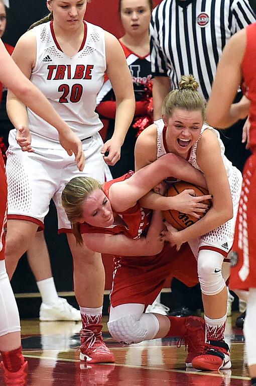 . Loveland High\'s #10 Lexi Eberhardt scuffles for the ball with Brighton\'s #30 Chloe Doyle during their game Tuesday, Feb. 21, 2017, at Loveland High School in Loveland. (Photo by Jenny Sparks/Loveland Reporter-Herald)