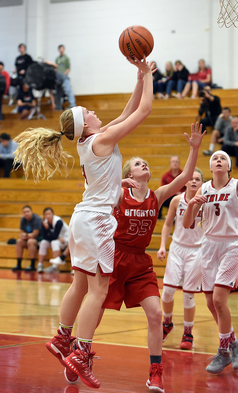 . Loveland High\'s #4 Skylar Boyce goes up for a shot past Brighton\'s #33 Mackenzie Dent during their game Tuesday, Feb. 21, 2017, at Loveland High School in Loveland. (Photo by Jenny Sparks/Loveland Reporter-Herald)
