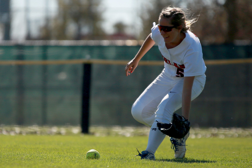 . Loveland�s (5) Jordan Irwin scoops up the ball in the outfield at the Colorado state championships during their game against Cherokee Trail at Aurora Sports Park on Oct. 20, 2018 in Aurora, Colo. Photo by Taelyn Livingston/ Loveland Reporter-Herald