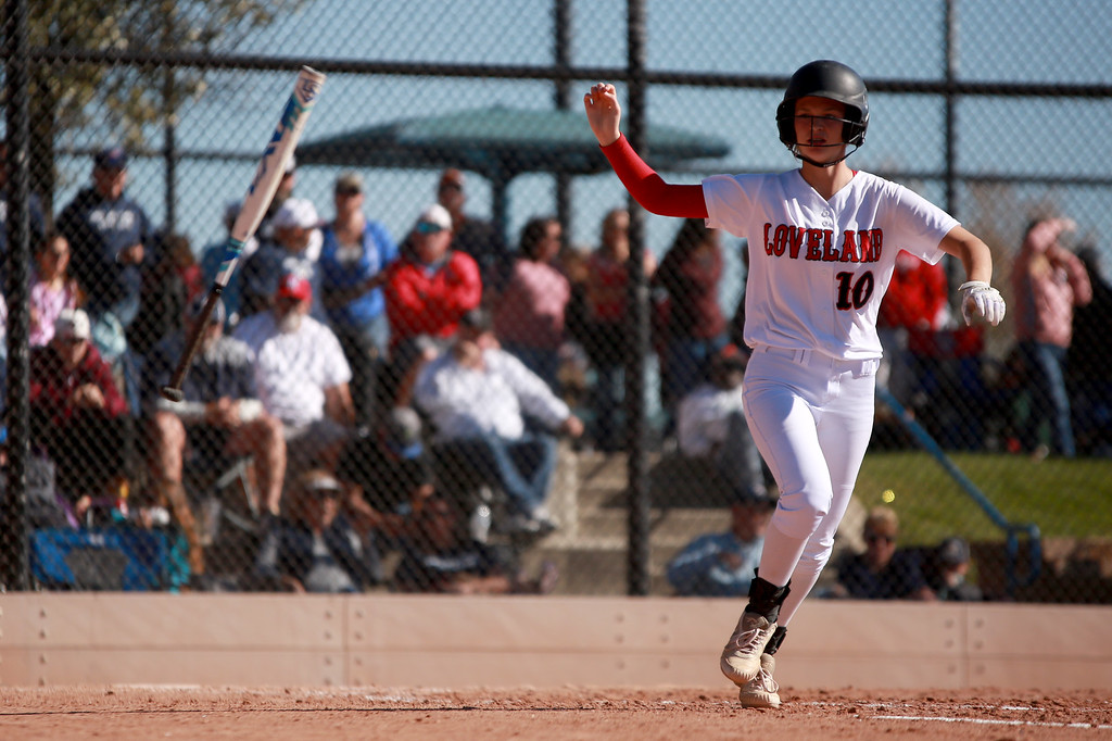 . Loveland�s (10) Sage Baldwin tosses the bat on her way to first base at the Colorado state championships during their game against Cherokee Trail at Aurora Sports Park on Oct. 20, 2018 in Aurora, Colo.Photo by Taelyn Livingston/ Loveland Reporter-Herald