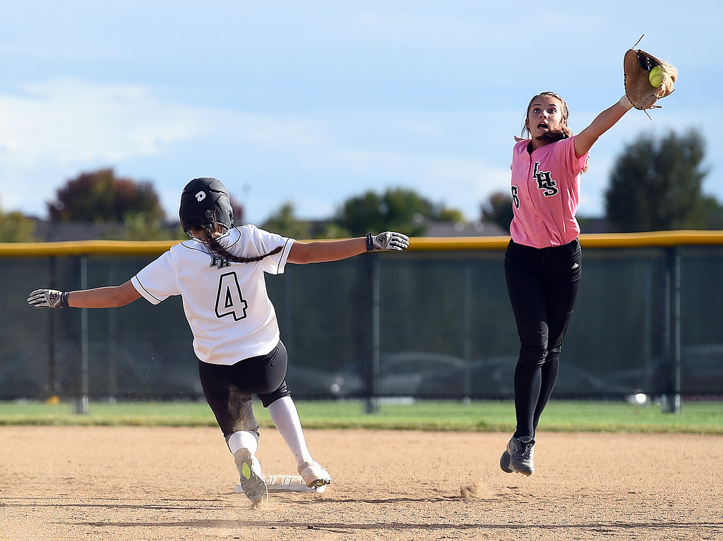 . Loveland\'s (6) Kammrie Bakovich catches the ball as Fossil Ridge\'s (4) Amber King tries to get to second base during their game Tuesday, Oct. 2, 2018, at Fossil Ridge High School in Fort Collins.   (Photo by Jenny Sparks/Loveland Reporter-Herald)