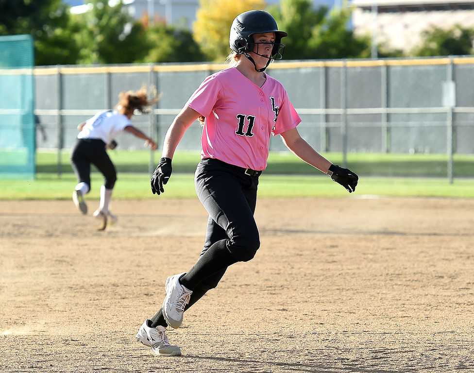 . Loveland\'s (11) Allison Westbrook runs to third base during their game against Fossil Ridge Tuesday, Oct. 2, 2018, at Fossil Ridge High School in Fort Collins.   (Photo by Jenny Sparks/Loveland Reporter-Herald)