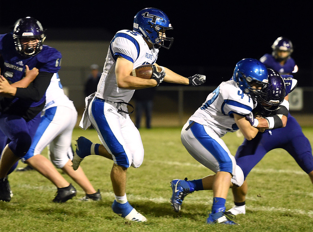 . Longmont\'s Drake Engelking takes the ball down field during their game against Mountain View on Thursday, Oct. 25, 2018, at Patterson Stadium in Loveland.  (Photo by Jenny Sparks/Loveland Reporter-Herald)
