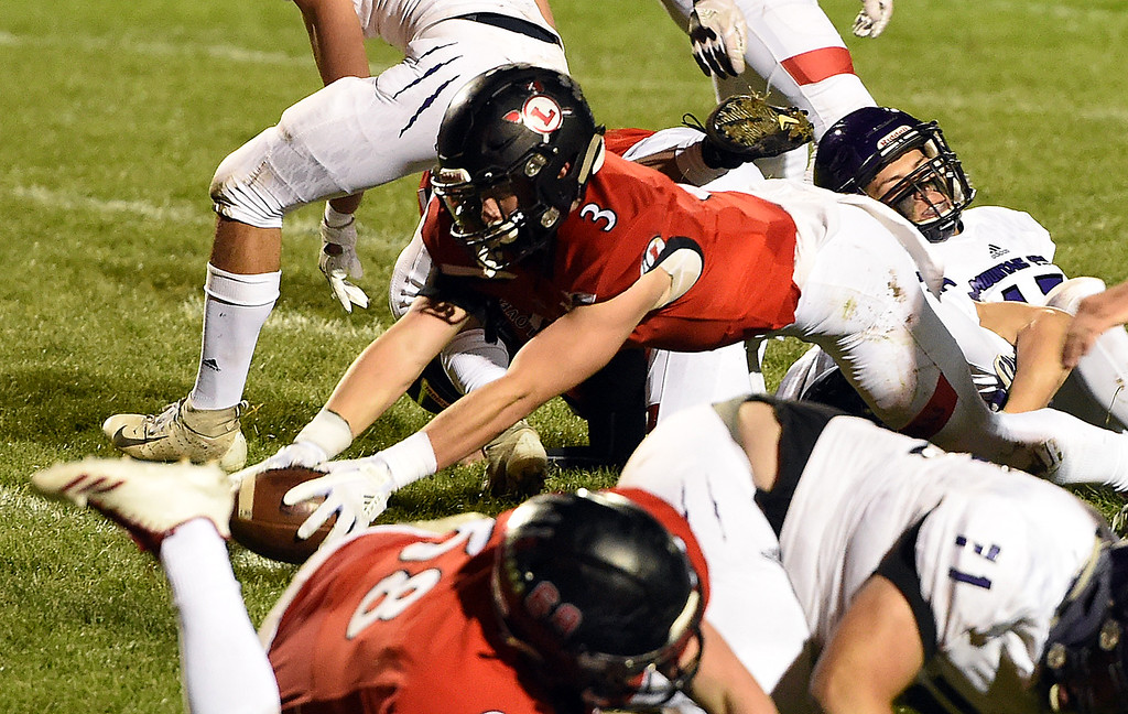 . Loveland\'s (2) Riley Kinney reaches for the goal line to score during their game against Mountain View Friday, Sept. 28, 2018, at Patterson Stadium in Loveland.   (Photo by Jenny Sparks/Loveland Reporter-Herald)