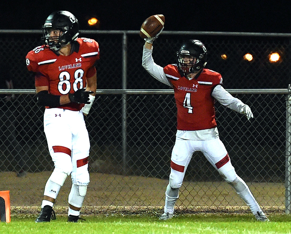 . Loveland\'s (4) Cody Rakowsky celebrates a touchdown during their game against Mountain View Friday, Sept. 28, 2018, at Patterson Stadium in Loveland.   (Photo by Jenny Sparks/Loveland Reporter-Herald)