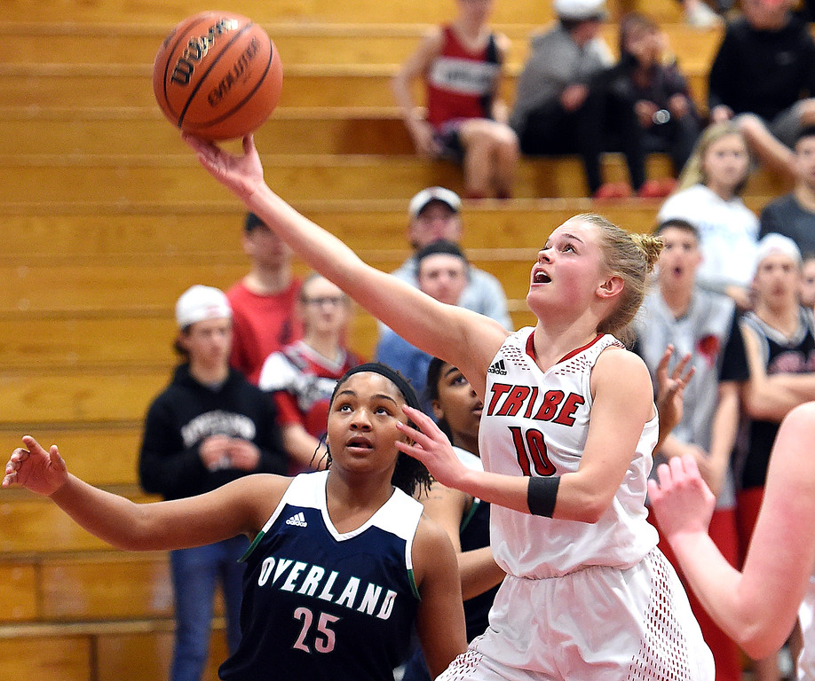 . Loveland\'s (10) Lexi Eberhardt goes up for a shot past Overland\'s (25) Kia Gelinas during their game Tuesday, Feb. 20, 2018, at Loveland High School.   (Photo by Jenny Sparks/Loveland Reporter-Herald)