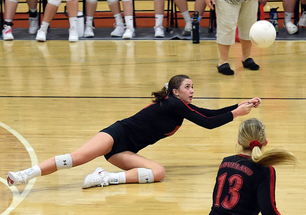 . Loveland\'s (10) Maddie Kinney hits a digger during their game against Rocky Mountain on Thursday, Oct. 18, 2018, at Loveland High School.  (Photo by Jenny Sparks/Loveland Reporter-Herald)