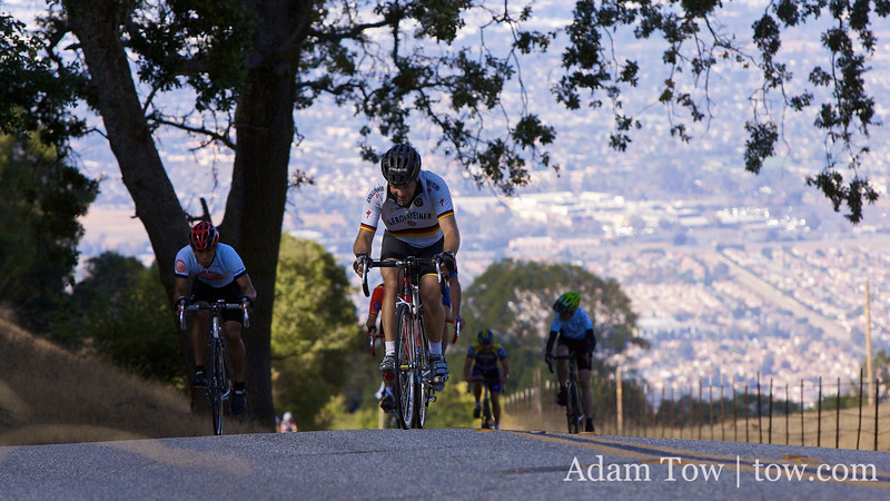 Ron Brunner has a pack of cyclists on his tail as he finished the climb up Quimby Road.