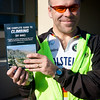 Ron holds up The Complete Guide to Climbing (By Bike).