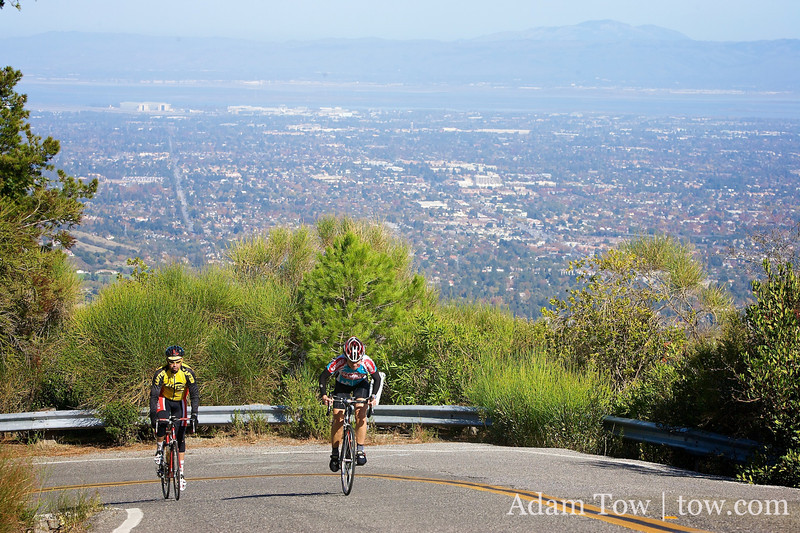 Silicon Valley looms in the background as riders make their way up On Orbit during the Week 6 Low-Key Hill Climb ride.