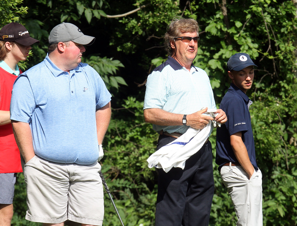 . Lowell City Golf Tournament first round. From left, Jeff Monahan, Doug Parigian and Eric Roy wait to tee off at the 9th hole. (SUN/Julia Malakie)