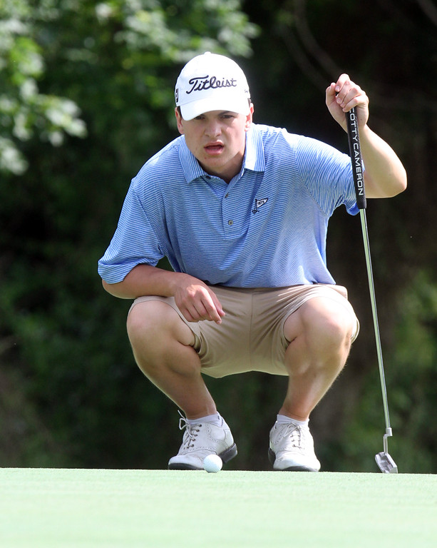 . Lowell City Golf Tournament first round. Cameron Sheedy studies his putt on the 5th hole. (SUN/Julia Malakie)