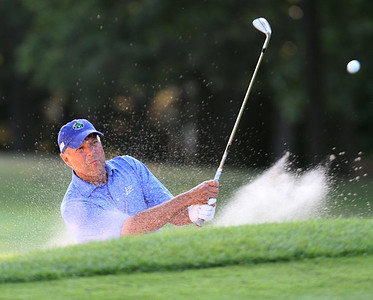 Final round of Lowell City Golf Tournament at Mt Pleasant Golf Club. George Popp of Vesper hits out of a bunker on the 14th hole. (SUN/Julia Malakie)