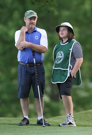 Final round of Lowell City Golf Tournament at Mt Pleasant Golf Club. Runnerup Phil Smith of Long Meadow stands with his daughter and caddy Molly Smith while waiting to putt on the final hole. (SUN/Julia Malakie)