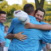 Final round of Lowell City Golf Tournament at Mt Pleasant Golf Club. Chris Gentle hugs Mt Pleasant teammates including Scott Trahan (back to camera) after winning the 2016 Cities. (SUN/Julia Malakie)