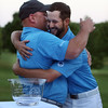 Final round of Lowell City Golf Tournament at Mt Pleasant Golf Club. Winner Chris Gentle of Mt Pleasant, right, hugs Mt Pleasant golf pro Joel Jenkins, left, who was presenting the trophy. (SUN/Julia Malakie)