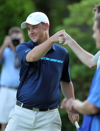 Final round of Lowell City Golf Tournament at Mt Pleasant Golf Club. Stephen Parise Jr. gets a fist bump after sinking a long putt on the final hole. (SUN/Julia Malakie)