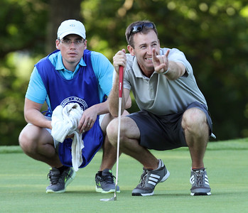 Final round of Lowell City Golf Tournament at Mt Pleasant Golf Club. Andrew Conway of Vesper, with caddy Matt Beck, waiting to putt on the 14th hole. (SUN/Julia Malakie)