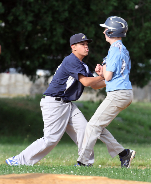 Lowell vs Dracut 14-15 year old Pony League baseball. Lowell third baseman Vic Sousa tags out Dracut baserunner Jon Dailey in the top of the first inning. (SUN/Julia Malakie)