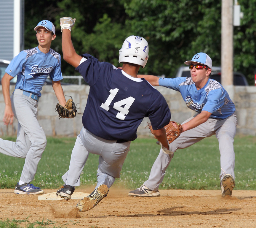 . Lowell vs Dracut 14-15 year old Pony League baseball. Lowell\'s Kyle Frechette (14) is safe at second with a stolen base as Dracut shortstop Harper Soucy, left, and second baseman Collin Arsenault, right, wait for the throw. (SUN/Julia Malakie)