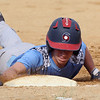 Lowell vs Dracut 14-15 year old Pony League baseball. Dracut's Collin Arsenault (14) dives back safely to first in the top of the first inning. (SUN/Julia Malakie)