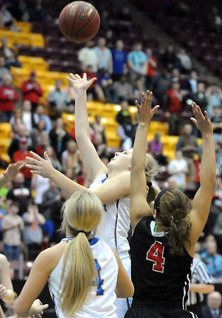Mankato Loyola's RaeAnn Dose makes a shot with two seconds left in regulation to send the game into overtime during the Class A quarterfinal game Thursday at Mariucci Arena. Pat Christman